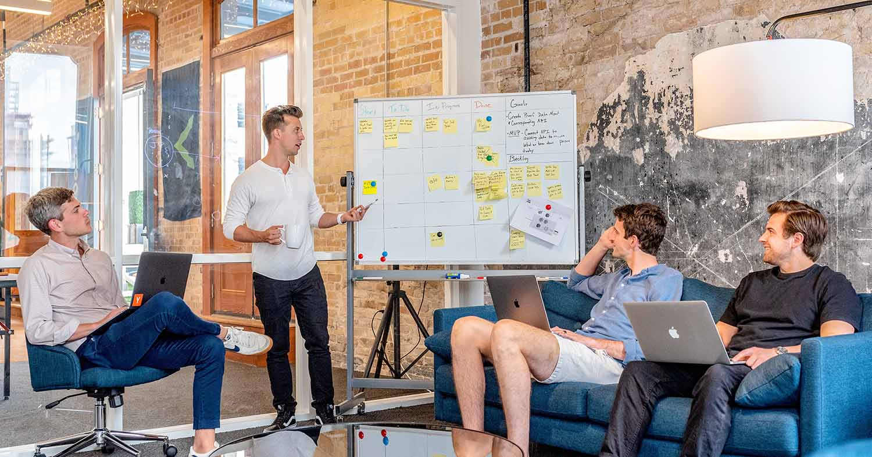 B2B vs B2C marketing - marketing team with whiteboard
